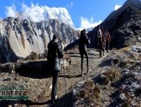 Trekkers heading up to Tserkuri Peak/ Langtang Valley Trek