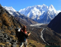 Trekker pointing the Kanchenjunga Himalayan Range/ Kanchenjunga South Base Camp Trek